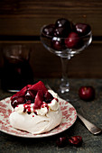 Meringue Nest with Cream, Poached Pears and Cherries