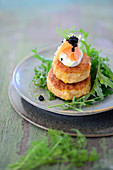 Salmon burger with rocket and dill sour cream