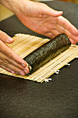 Vegan nori maki being rolled up