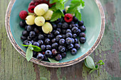 Colourful summer berries in a small bowl