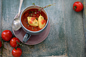 Cold tomato soup with ricotta-semolina dumplings
