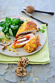Breaded stuffed chicken breast on lamb's lettuce