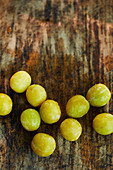 Fresh yellow plums on a wooden surface