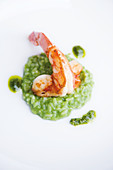 Fried giant prawns on wild garlic risotto