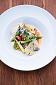 Wild herb ravioli with glazed spring vegetables