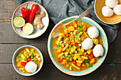 cauliflowr, pumpkin and bean curry with rice balls