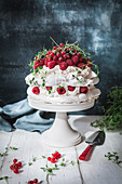 Meringues with cream and filled with raspberries and red currants