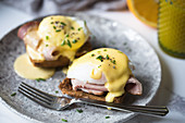 Breakfast dish of ham, poached eggs and hollandaise sauce