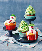 Christmas cupcakes with Christmas tree and snowman decorations