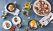 Four different Christmas desserts with spices, honey and nuts