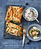 Salmon in puff pastry served with rice (Christmas)