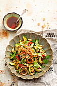 Asian cucumber salad with chili, nuts and cilantro