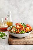 Shrimps on red quinoa salad