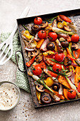 Colourful oven vegetables with a sesame and yoghurt dip