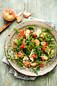 Gluten-free rocket and peach salad with parma ham