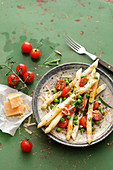 White asparagus salad with tomatoes, peas and parmesan