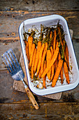 Oven roasted baby carrots in a dish
