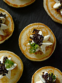 Blinis with caviar (seen from above, close-up)