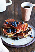 Toast with bacon, blueberries and maple syrup