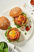 Veggie burgers with tomatoes and cheese