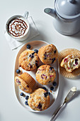 Berry muffins with coffee (seen from above)