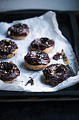 Vegan coffee and hazelnut doughnuts with chocolate glaze