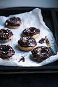 Vegan coffee and hazelnut doughnuts with chocolate glaze