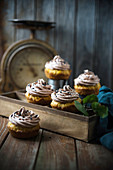 Vegan pumpkin cupcakes with chocolate cashew frosting and sugar decorations