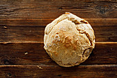 Potato bread on wooden background