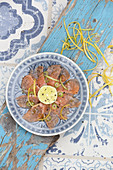 Bavaria meets Italy – salmon trout carpaccio with Aperol vinaigrette