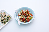 Tomato and courgette salad with Emmental cheese and oats