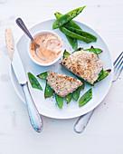 Pork escalope with a sesame seed crust, mange tout and quark dip