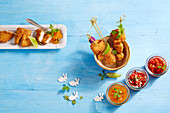 Breaded chicken skewers with three tomato dips for Easter
