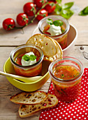 Tomato jelly with basil cream in jars
