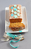 A carrot loaf cake decorated with icing and fondant animals