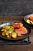 Meatloaf schnitzel with fried potatoes