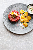 Beef tartare with potatoes and creamy sauce