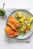 Wiener schnitzel (breaded veal escalopes) with potato and herb salad