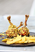 Grilled chicken drumsticks with a crunchy coating