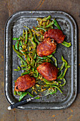 BBQ style glazed chicken drumsticks with Indian sliced peppers