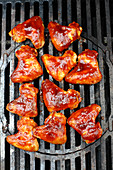 Sweet and sour chicken wings on a grill