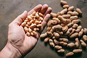 Man holding peanuts