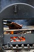 A flat iron steak on a grill
