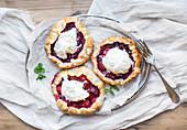Rustic small galeta pies with fresh berries and vanilla ice-cream