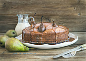 Pear, ginger and honey cake with creamy caramel topping and fresh pears