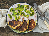 Rustic breakfast set with fluffy pancakes with strawberry yogurt and fresh kiwi