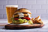 Vegetarian chickpea burger, with fries and a glass of beer
