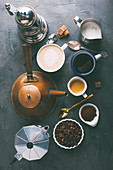 Different types of coffee and coffee makers on dark background