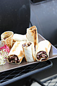 Veggie wraps with pumpernickel, beans, sprouts and cheese