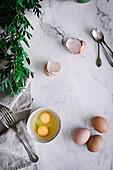 Raw eggs on marble tabletop